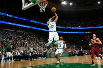 BOSTON, MA - NOVEMBER 30: Marcus Smart #36 of the Boston Celtics dunks the ball against the Cleveland Cavaliers on November 30, 2018 at the TD Garden in Boston, Massachusetts. NOTE TO USER: User expressly acknowledges and agrees that, by downloading and or using this photograph, User is consenting to the terms and conditions of the Getty Images License Agreement. Mandatory Copyright Notice: Copyright 2018 NBAE (Photo by Brian Babineau/NBAE via Getty Images)